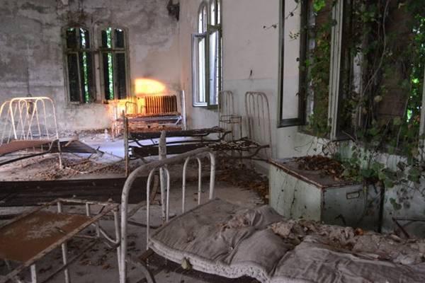 Một phòng bệnh bỏ hoang trên đảo Poveglia - Ảnh: wordpress